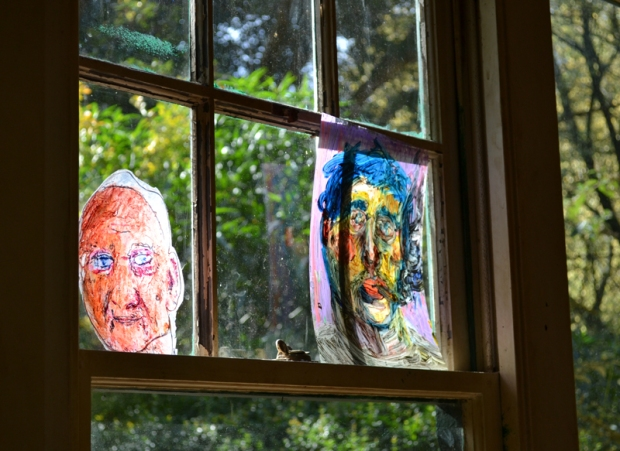 portraits at window