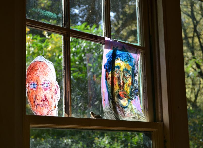 portraits at window